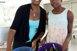 Two young ladies showing their finished pots