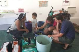 Family making final touches to their pots